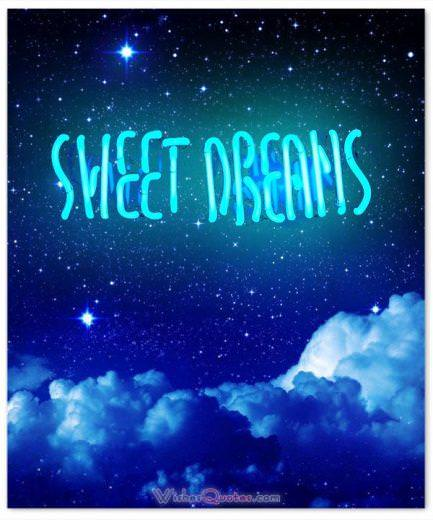 Good night message. A dark sky with clouds and a neon light with the message sweet dreams.